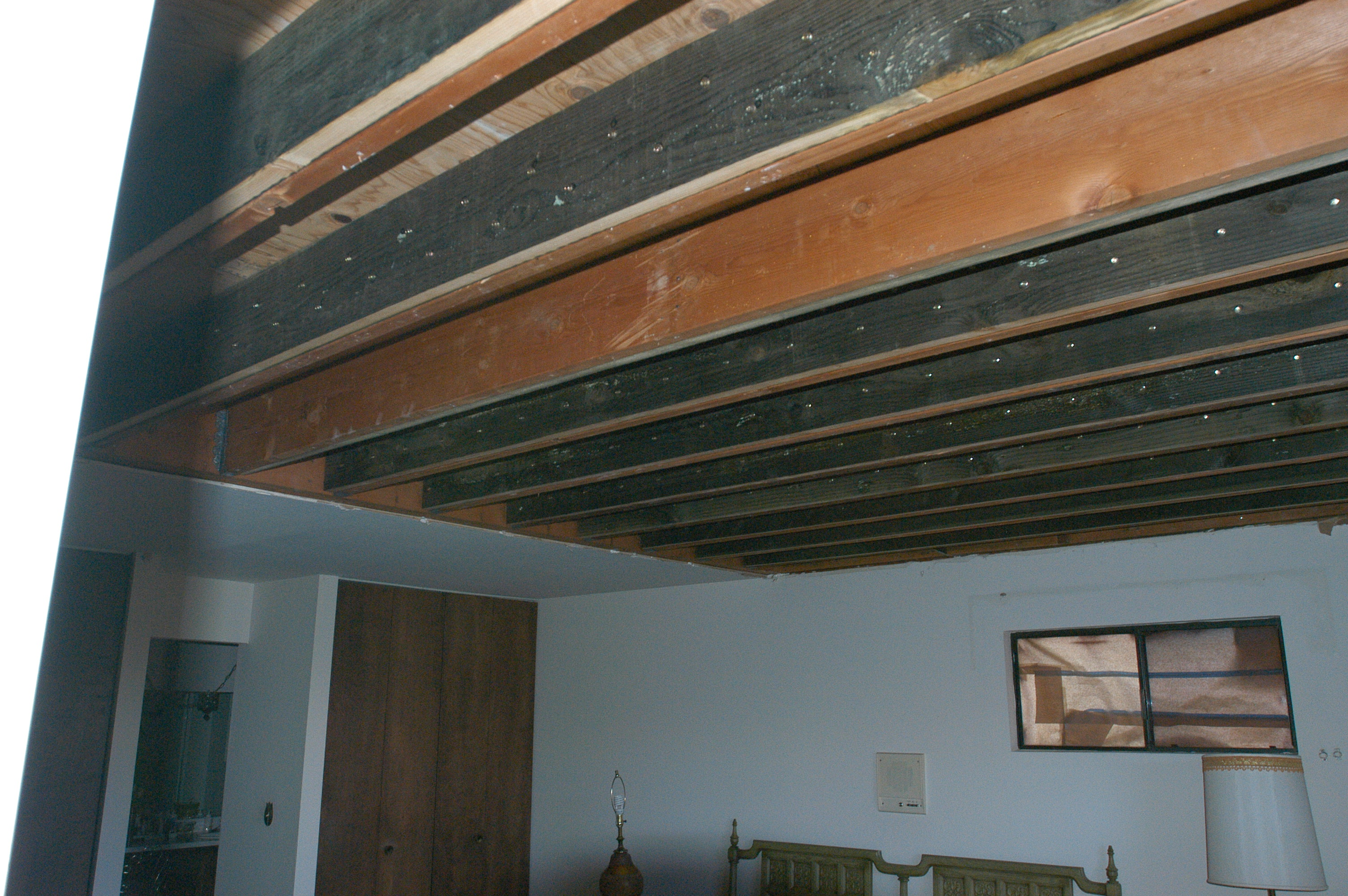 Replacement of Cantilevered Joists Requires Opening Ceiling Inside House